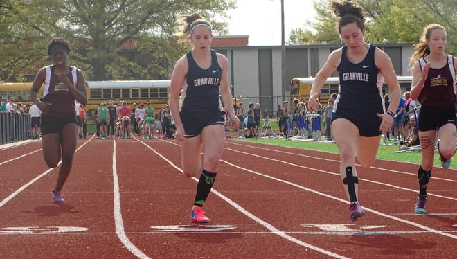 Granville freshman Mackenzie Everett and sophomore Penny Hunter reach the finish line in the 100 this past Friday during the Licking County League-Buckeye Division finals at Lakewood.