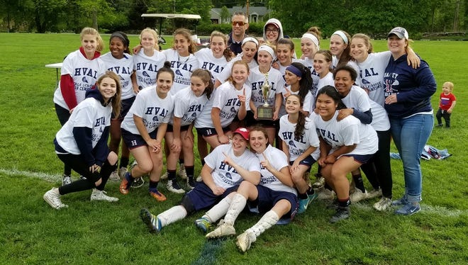 Harvey's girls lacrosse team poses after winning the HVAL championship game over Wooster on Friday, May 18th, 2018.