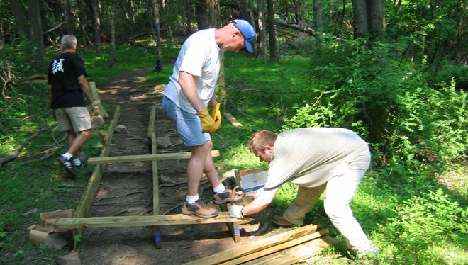 Volunteers work to repair trails on National Trails Day.