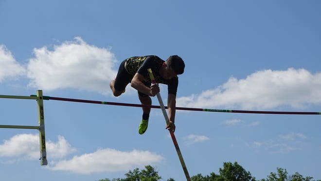 Watkins Memorial junior Austin Ballenger clears the bar in the pole vault May 23 during the Division I regional meet at Pickerington North.