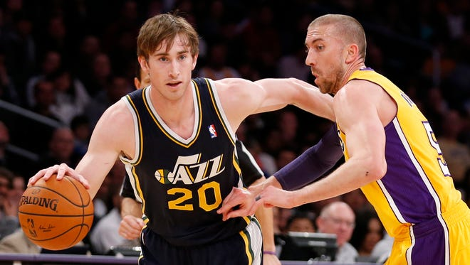 Utah Jazz's Gordon Hayward, left, drives past Los Angeles Lakers' Steve Blake in Los Angeles, Feb. 11, 2014.