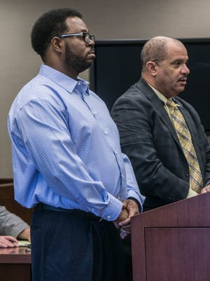 Defendant Michael Edward Hearn stands in Judge Sean Kavanagh's courtroom with his attorney, Terry L. Johnson.