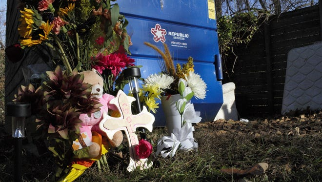 A memorial for Kayla Hensley by the dumpster where her body was found