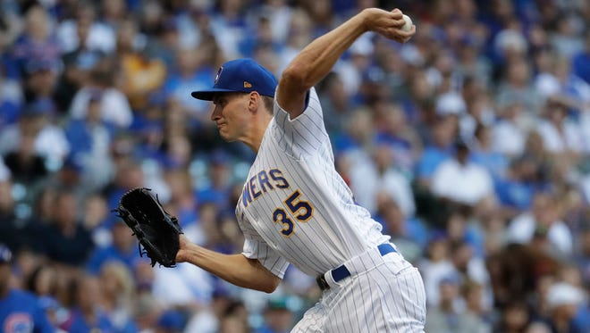Brent Suter scattered four hits over seven shutout innings Friday night for the Brewers.