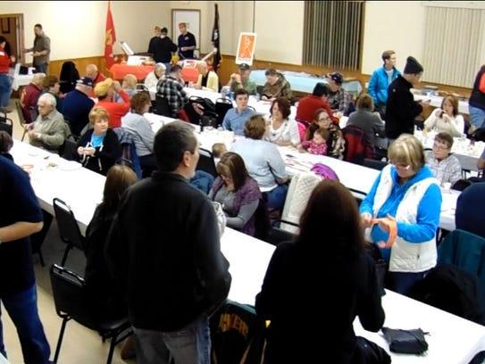 Community members take part in Navy Club Ship 75's