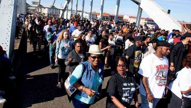 Marchers cross the bridge during the re-enactment of the Bloody Sunday march across the Edmund Pettus Bridge in Selma, Ala. on Sunday March 6, 2016.