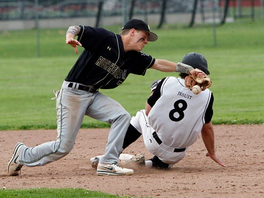 Rush-Henrietta's Bryan Sidote, left, can't hold onto a throw as McQuaid's Jeff Weber slides in safely during the Knights' 4-0 win Wednesday.