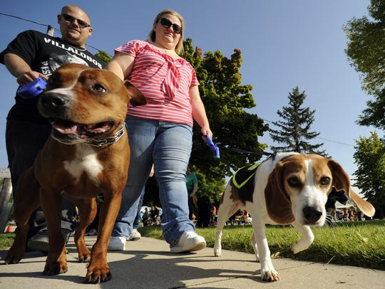 Dog owners Aaron and Lindsey Hansen of Manitowoc participate