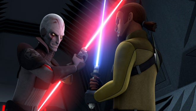 """The Inquisitor (voiced by Jason Isaacs) faces off in a lightsaber dual with the Jedi Kanan (Freddie Prinze Jr.) in  """"Star Wars Rebels."""""""