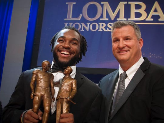John Lombardi, pictured here presenting the Lombardi Award to 2017 winner Bryce Love, is bringing his line of Lombardi beers to Tennessee beginning May, 2018.