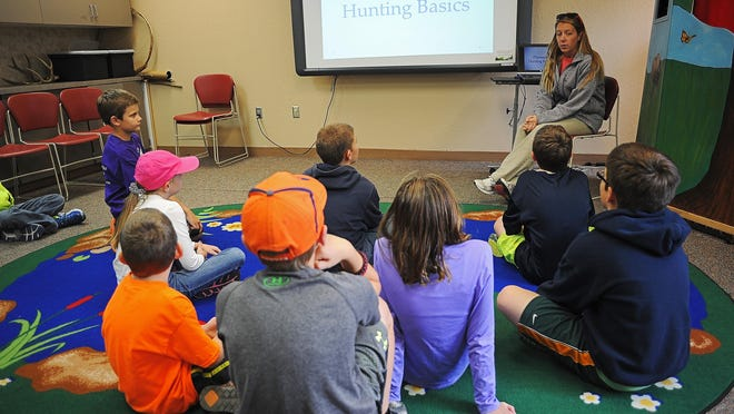 Natalie Brandt, who has been a naturalist intern for three years, speaks to students in a pheasant hunting basics class at The Outdoor Campus.