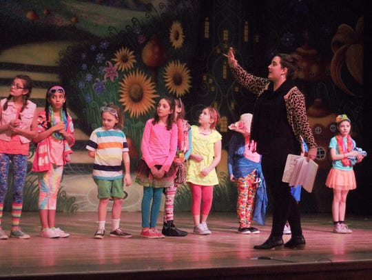 Director Emily Yaksic gives directions to her young actors during a dress rehearsal on Tuesday.