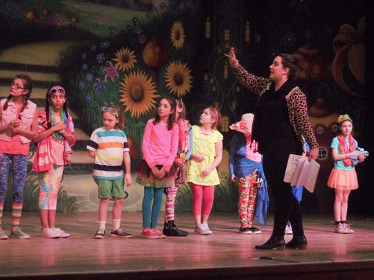 Director Emily Yiksic gives directions to her young actors during a dress rehearsal on Tuesday.