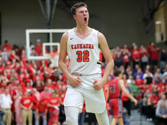 Kaukauna's Dylan Kurey (32) reacts after the Ghosts forced a Pulaski turnover in a WIAA Division 2 sectional semifinal game at Preble High School on Thursday, March 8, 2018 in Green Bay, Wis.