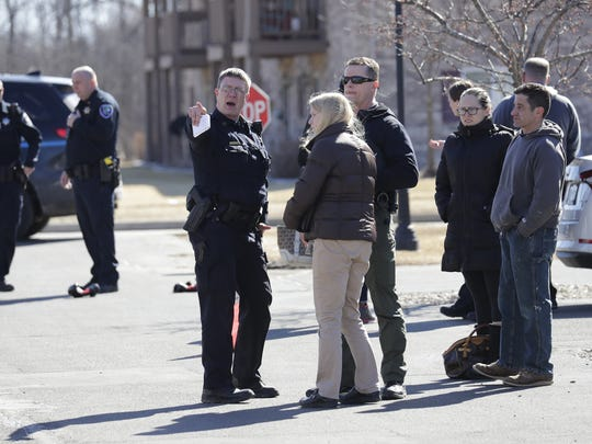 Officials talk to residents after an incident at Craftsman Village of Appleton located at 410 Schindler Place Thursday in Appleton.