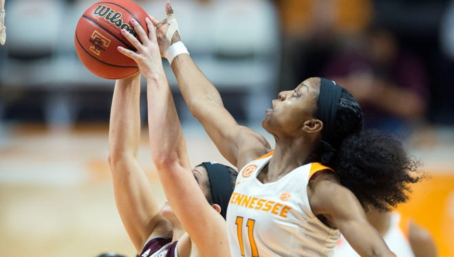 Tennessee's Diamond DeShields, right, in a game earlier this season against Texas A&M, was taken off the court on a stretcher during Thursday's game against Alabama.