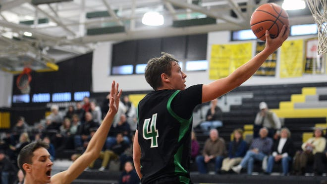Mountain Heritage's Avery Austin goes up for a shot during a 2014 game against Robbinsville.