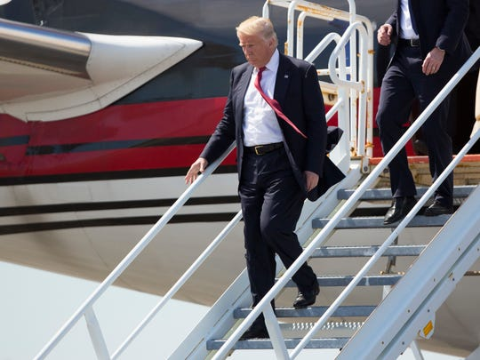 Republican presidential candidate Donald Trump steps off his plane after arriving for a campaign rally at Germain Arena, Monday, Sept. 19, 2016, in Ft. Myers, Fla.