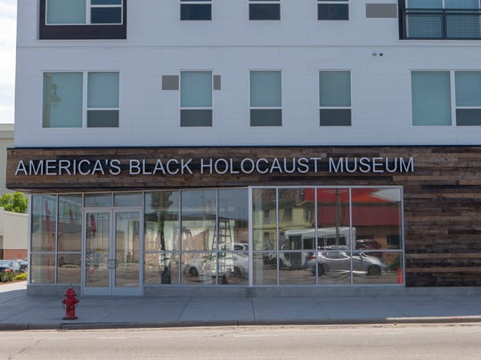 The front of America's Black Holocaust Museum faces North Ave at the bottom of the Griot apartments in Halyard Park. The museum is set to reopen this fall after a 10-year hiatus.