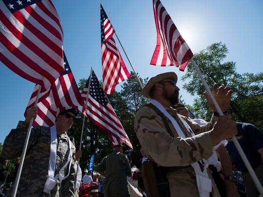 Veterans Plaza of Northern Colorado parade participant get setup before the Independence Day parade on Wednesday, July 4, 2018, in Fort Collins, Colo.