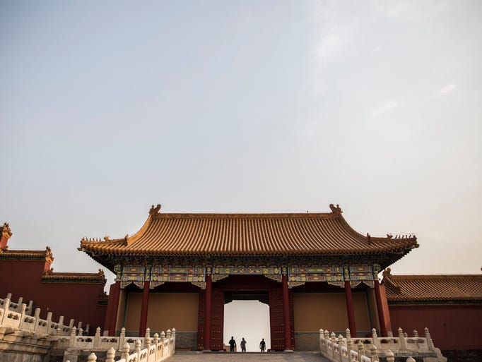 Tourists wander through the Forbidden City on Thursday,