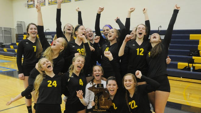 Mercy players pose with the championship trophy after winning a regional tournament in volleyball Thursday night.