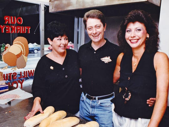 Capriott's founder Lois Margolet, left, with her brother Alan and Diane Brindle at the Capriotti's on Union Street in Wilmington in 1992.