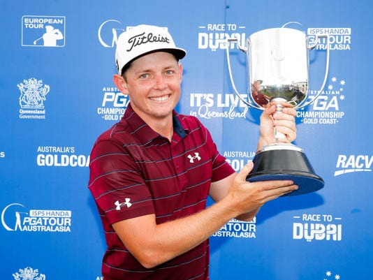 Golfer Cameron Smith holds the trophy after winning the Australian PGA Championships at RACV Royal Pines Resort on Sunday, Dec. 3, 2017 in Gold Coast, Australia. Smith won the Australian PGA Championship on Sunday with a par on the second hole of a playoff with fellow Australian Jordan Zunic. (Glenn Hunt/AAP Image via AP)
