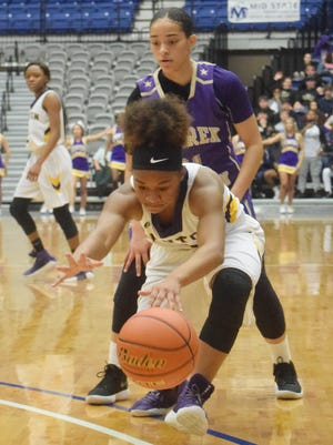 Benton High School's Jade Anderson (1, front) goes up after a loose ball against Warren Easton's Kalyn Green (21, back) in the LHSAA Class 4A semifinals held Tuesday, Feb. 27, 2018 at the Rapides Parish Coliseum in Alexandria.