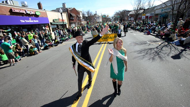 Grand Marshall John Hyland and wife Kristin march in the 38th annual Morris County St. PatrickÕs Day Parade, one of the largest in the state, drawing tens of thousands of spectators and marchers to the streets of Morristown. March 12, 2016. Morristown, N.J.