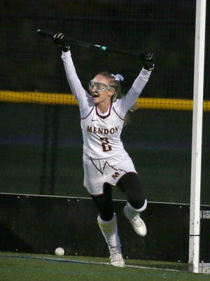 Pittsford Mendon's Kenzie Peterson celebrates her second half goal that gave Mendon a 2-0 lead over East Rochester during their Section V Class B/C field hockey final Monday at Webster Schroeder.  Mendon won 2-0.