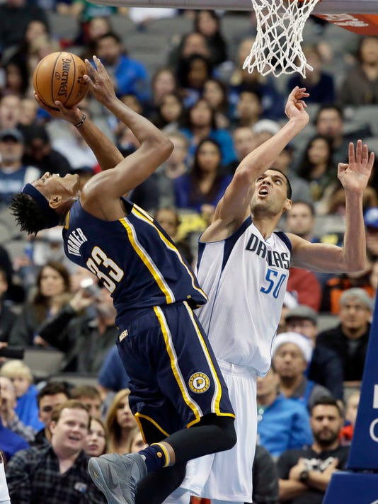 Dallas Mavericks center Salah Mejri (50) defends the basket against Indiana Pacers center Myles Turner (33) during the second half of an NBA basketball game in Dallas, Friday, Dec. 9, 2016. The Mavericks won 111-103. (AP Photo/LM Otero)