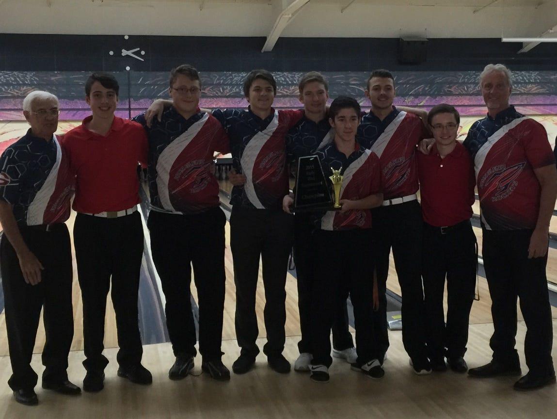 Pictured are (from left) coach Staples, Sr., Michael Pizzuti, Damien Strohschein, Kyle McCarthy, Jared Stevens, Matt Essa, Brian Martin, Ryan Brawdy and coach Staples.
