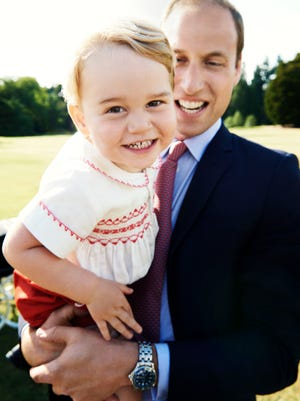 Britain's Prince William holds his son Prince George following the christening of Princess Charlotte, in the grounds of Sandringham House, England, Sunday, July 5, 2015. The photo has been released in time for Prince George's second birthday on Wednesday, July 23, 2015.