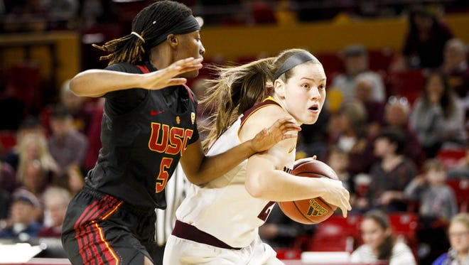 ASU senior forward Sophie Brunner (21) drives to the basket as USC freshman forward Ja'Tavia Tapley (5) defends in the first quarter at Wells Fargo Arena in Tempe on Friday, Feb. 24, 2017.