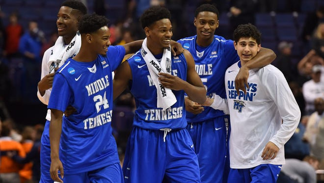 Middle Tennessee Blue Raiders players celebrate after the game against the against the Michigan State Spartans in the first round in the 2016 NCAA Tournament.