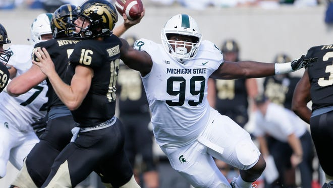 Raequan Williams (99) and Mike Panasiuk have become a disruptive duo on MSU's interior defensive line.