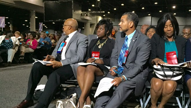 Cincinnati branch leaders (from left) Rob Richardson Sr., Nicole Taylor, Joe Mallory and Theresa Harper prepare to vote at NAACP delegate meeting Tuesday morning.