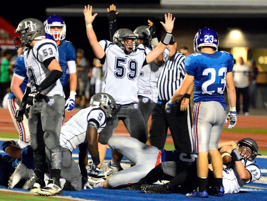 Dallastown's Ben Ferree (59) signals a was one of 62