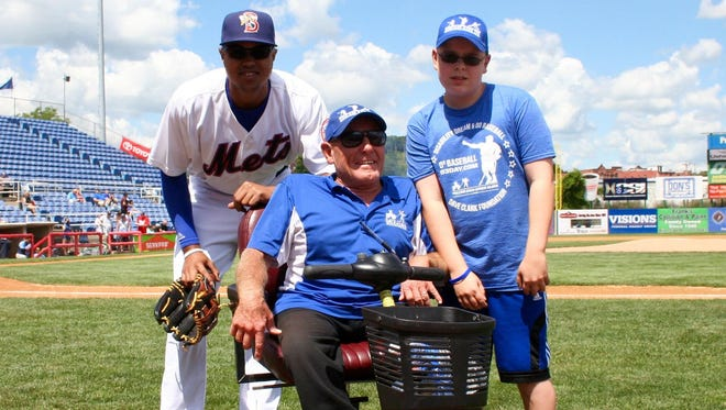 B-Mets outfielder Gilbert Gomez, left, poses for a photo with Dave Clark, center, and Ryan Strom, of Endicott, who threw out the first pitch during the D3 weekend at NYSEG Stadium.