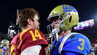 Josh Rosen #3 of the UCLA Bruins and Sam Darnold #14 of the USC Trojans meet on the field after a 28-23 Trojan win at Los Angeles Memorial Coliseum on November 18, 2017 in Los Angeles, California.