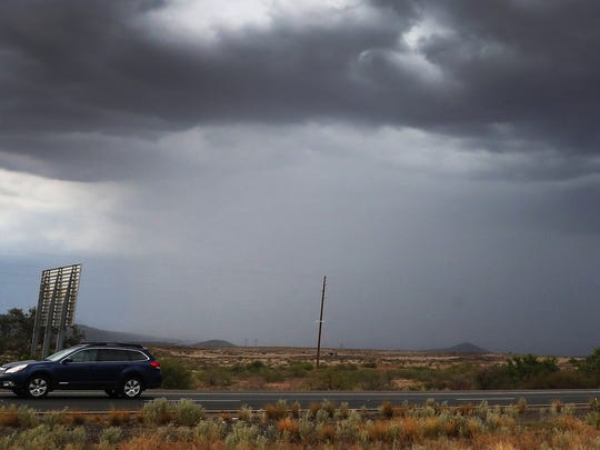 Rain falls east of Cordes Lakes, Arizona, on July 11,