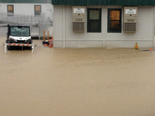 The City Hall parking lot and temporary trailers in Rehoboth Beach are flooded from heavy rains on Monday, Sept. 19.