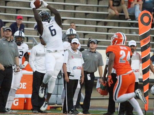 Old Dominion wide receiver Zach Pascal, 6, reach high for a catch against UTEP Saturday in the Sun Bowl in El Paso, TX. At right is UTEP defensive back Brendan Royal, 24,