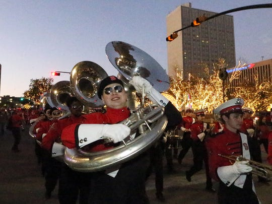 The North Carolina State Wolfpack band marches along Oregon Street to the El Paso Convention Center Thursday.