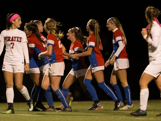 Wall celebrates after scoring their first half goal.