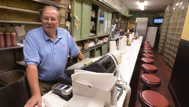 Chris' Hotdogs owner Theo Katechis mans the restaurant's cash register on  Jan. 5, 2014.