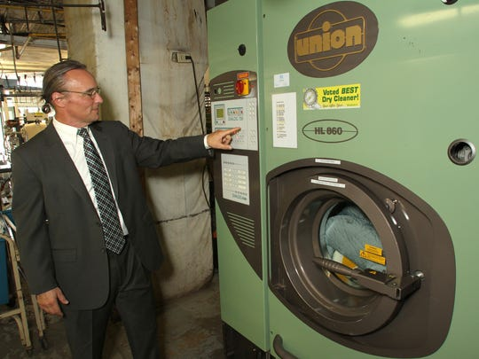President Jim Gilligan programs Snedicor's Green Earth Dry Cleaning system at the Howell location. The system uses environmentally friendly chemicals proven safe and inert, an improvement over systems used previously by many cleaning operations.