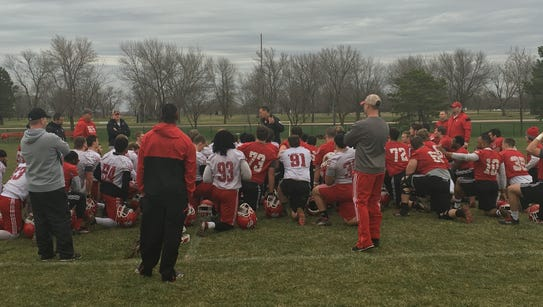 Coach Bob Nielson addresses the Coyotes on the first