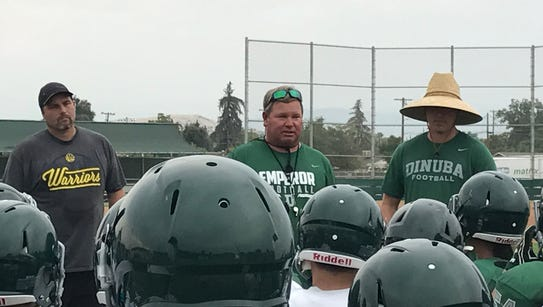 Dinuba head football coach Kevin Scharton addresses